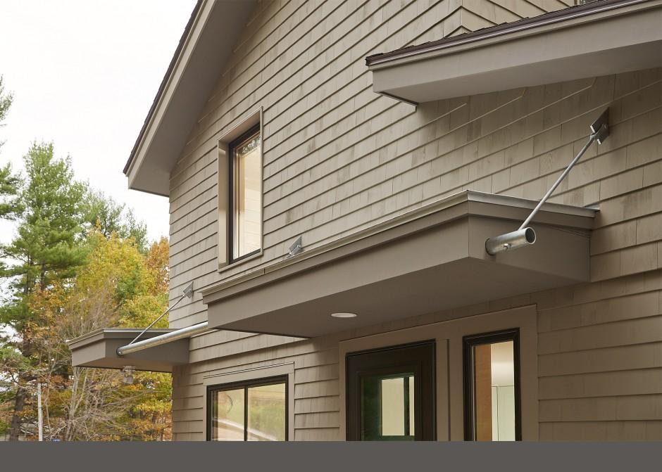 Hanging roof, cedar shingles, galvanized pipe, Maine Architect