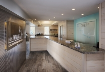 Entrance, Serpentine Desk, Stainless steel counter, diamond plate wall finish, Maine Architect