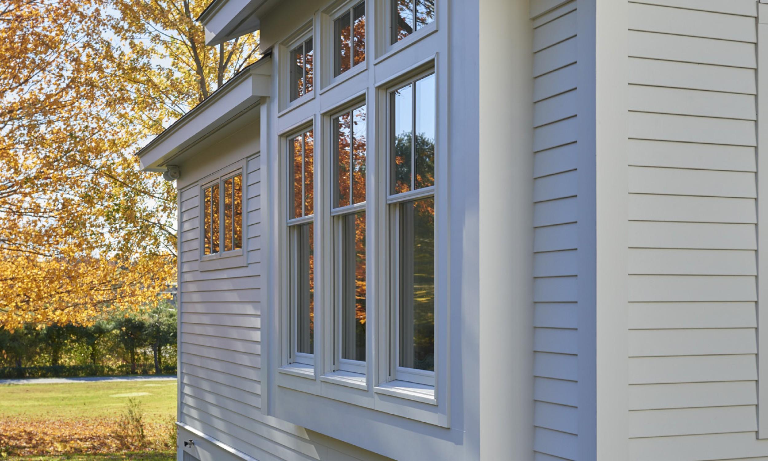 Bay window, white siding, clapboards, cement board siding, Maine Architect