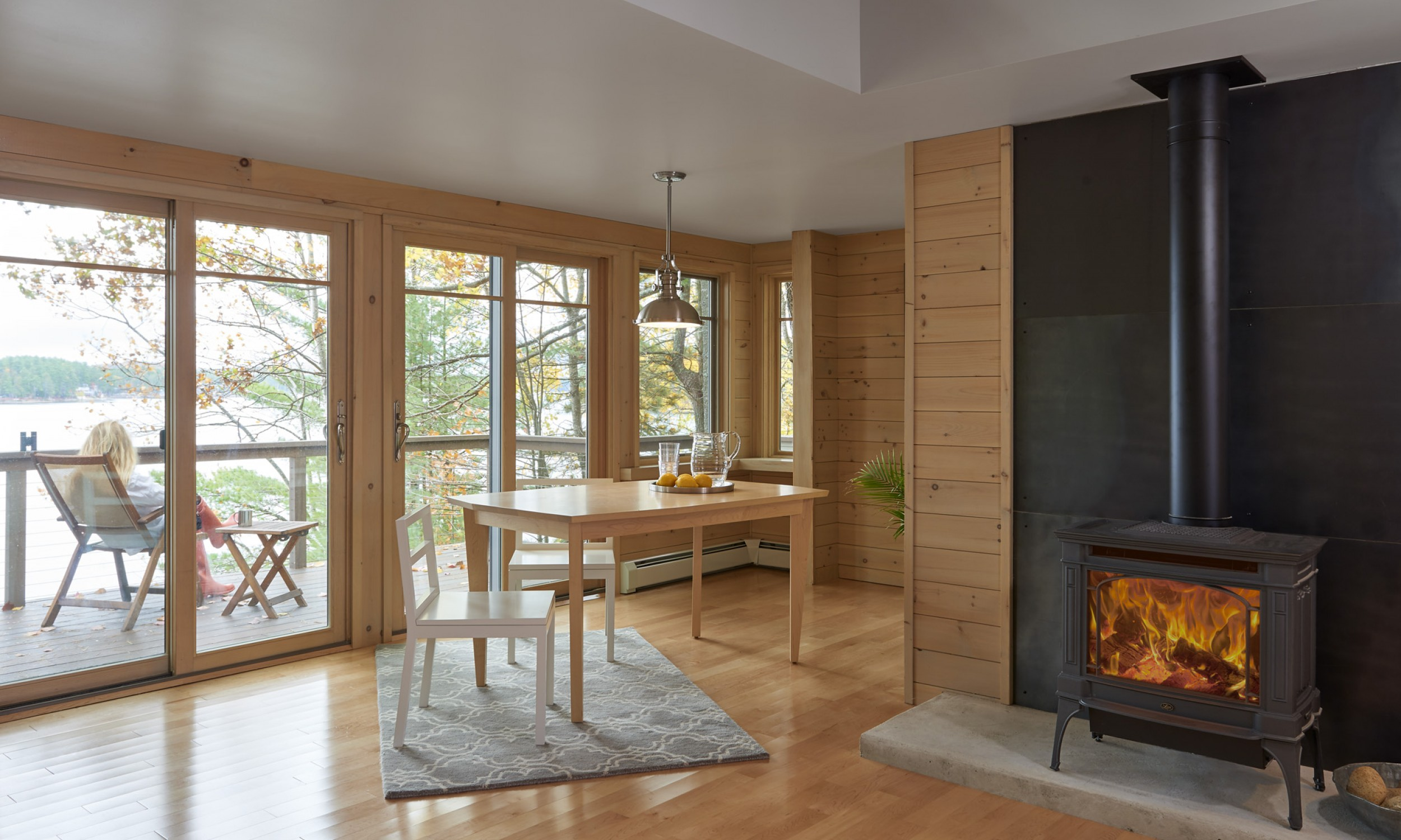 Gas stove, maple flooring, lake view, Maine Architect, Concrete hearth